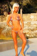 Natali strips her microkini on the beach 00