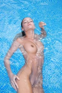 Veronika is proud to be naked at the pool