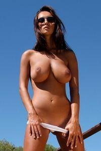 Busty brunette outdoors