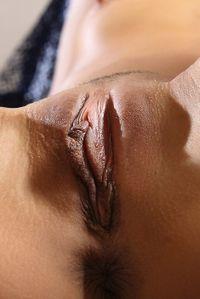 Naked brunette & her shaved pussy