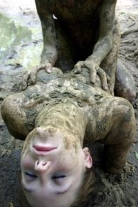 A Couple Have Fun Playing In The Mud